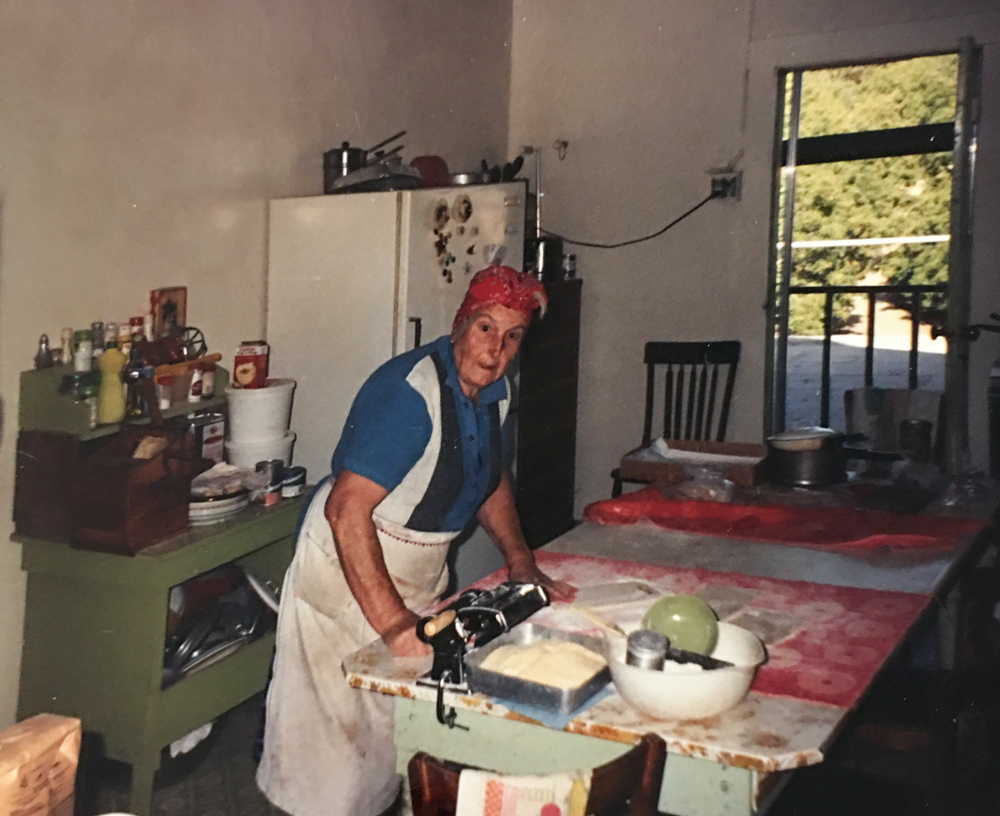 Rina Martinell in kitchen making pasta.