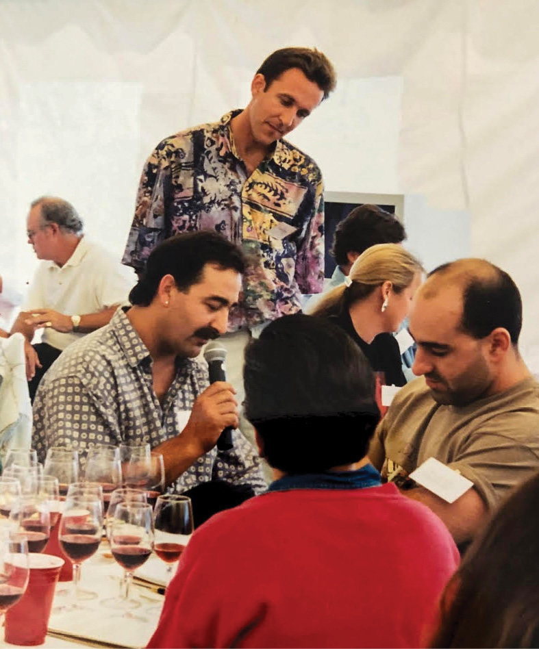 Frank Ostini of the Hitching Post (holding microphone), Brian Talley (Talley Vineyards) and John Clerides (Maquis Wine Cellars in Vancouver, British Columbia), during the dual Pinot Noir tasting event, which was live streamed between Arroyo Grande, California and New York City in celebration of the 10th Anniversary of Talley Vineyards in 1996. Photo credit: Dan Hardesty.