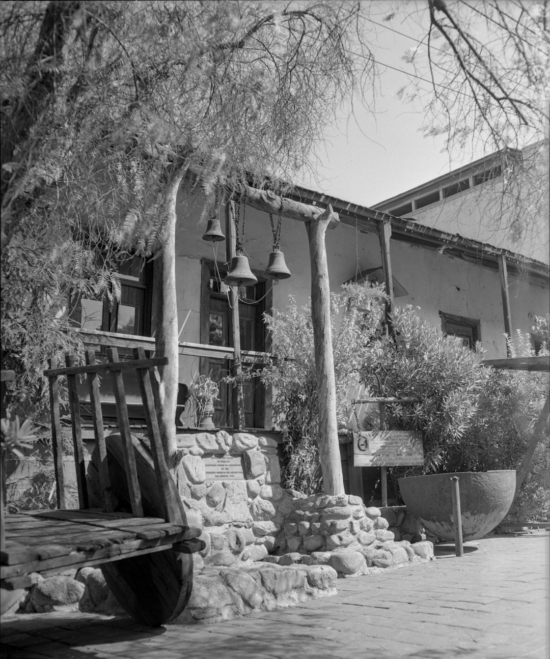 Avila Adobe, 1956. Front porch and marker of Avila Adobe on Olvera Street, Los Angeles, University of California, Los Angeles. Library Special Collections, Los Angeles Times photographic archive.