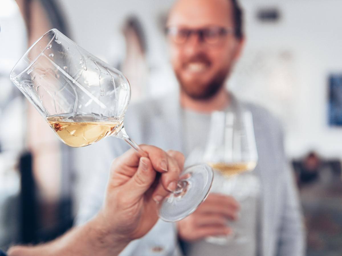 Man smelling wine in a tasting room