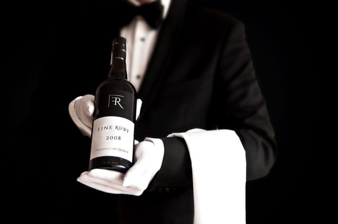 Waiter holding wine