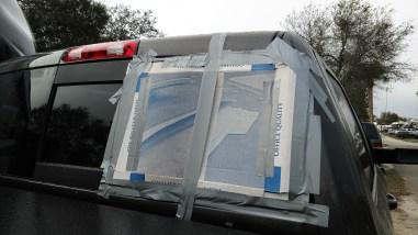 Cardboard over the broken rear window of the 2015 RAM 3500, February 10, 2018
