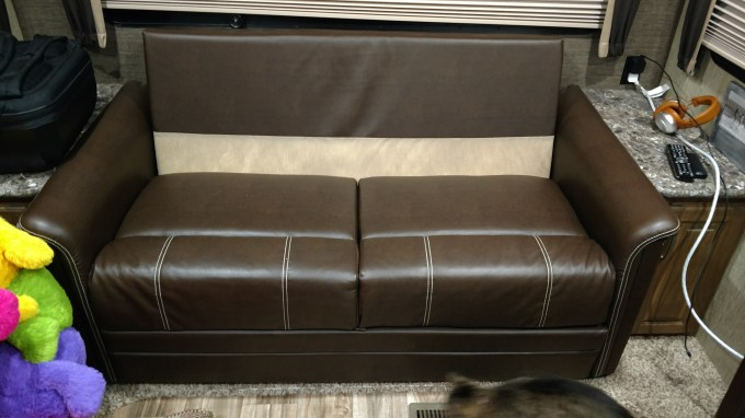 Sofa bed - the back cushions remove, the front forlds out and the back folds down