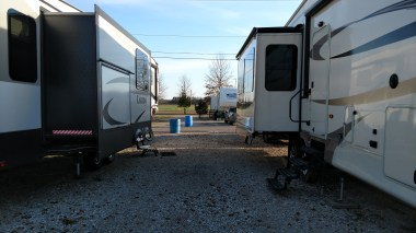 """Site 140 (on left) Agricenter RV Park West to East - we share """"public"""" space with our neighbors"""