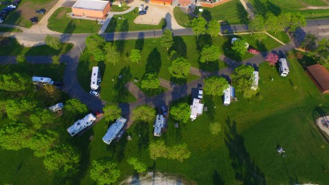 The campsites of Hoffman Park, River Falls, WI (we are the far right RV by the brown building)