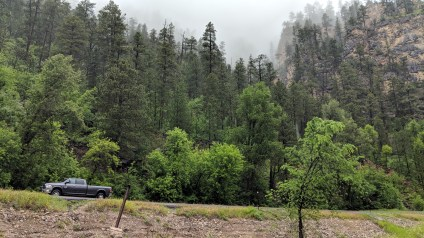 Our 2015 RAM Truck dwarfed by the Spearfish canyon walls while we explore along the creek bed, this day was really rainy and hazy, made for interesting views of the rock formations but we did not get to see the views