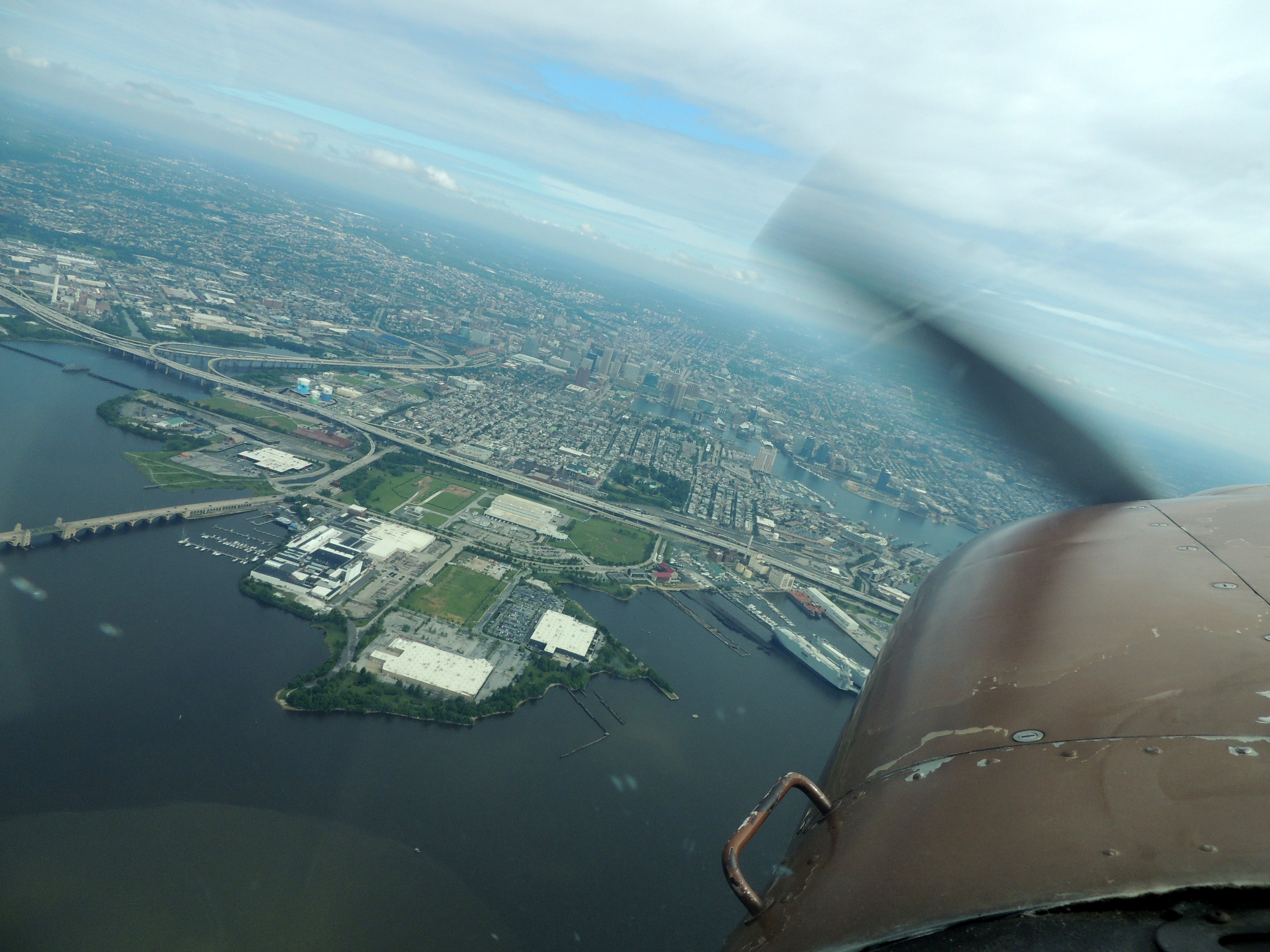 Turning left out over Inner Harbor after departing runway 15L at BWI