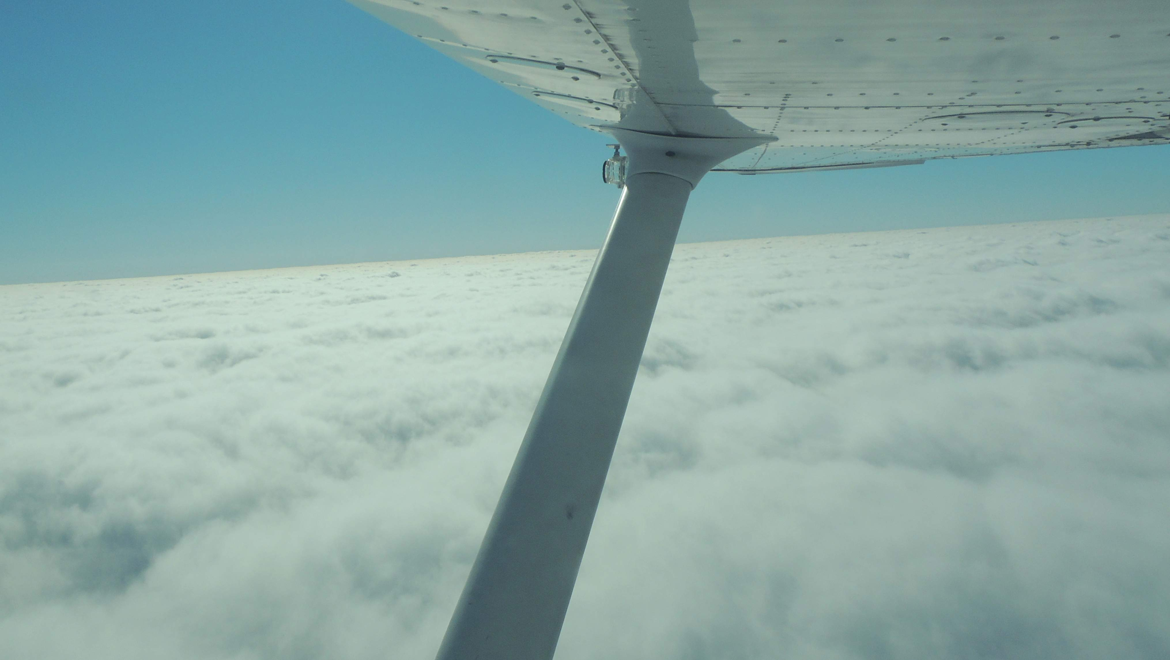 Climbing up and out of the clouds after departing Wheeling WVa