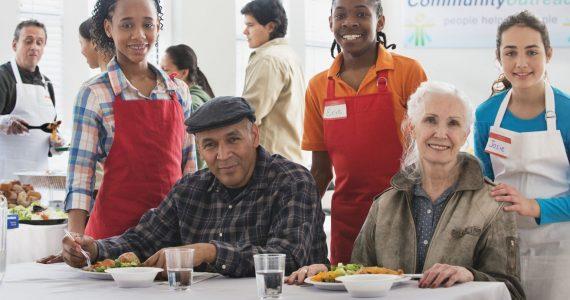 Volunteers serving food at community kitchen