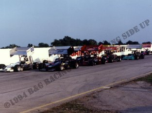 Dave McKnight, Jr. and Mike Muldoon lead the pack into turn 3 at Sandusky Speedway for the start of a heat.