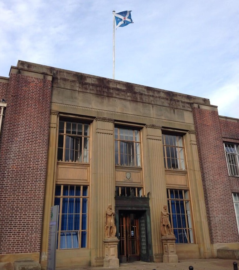 Stirling Council, Scotland, with the soon to be lowered Scottish Saltire featuring the town's coat of arms