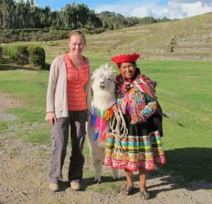 Sally Watson with llama and Peruvian woman
