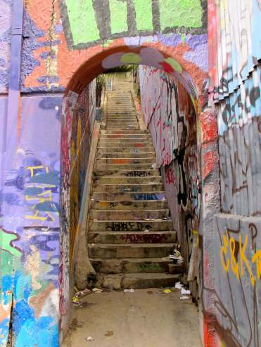 Street art in Valaparaiso, Chile. Graffiti, street art and rubbish consume this staircase.