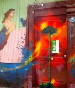 Street art in Valaparaiso, Chile. Mystical tree door..
