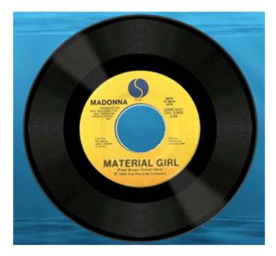 An image showing the vinyl single of Madonna's Material Girl, as included in the discussion of the cover version arranged and performed by composer Winifred Phillips for the video game Sackboy: A Big Adventure.