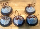 Blue Velvet Cupcake with Blue Cream Cheese Frosting Garnished with Chocolate Tuile & White Chocolate Pearls