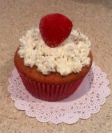 Strawberry Basil Cupcake with Basil Buttercream garnished with a Fresh Strawberry
