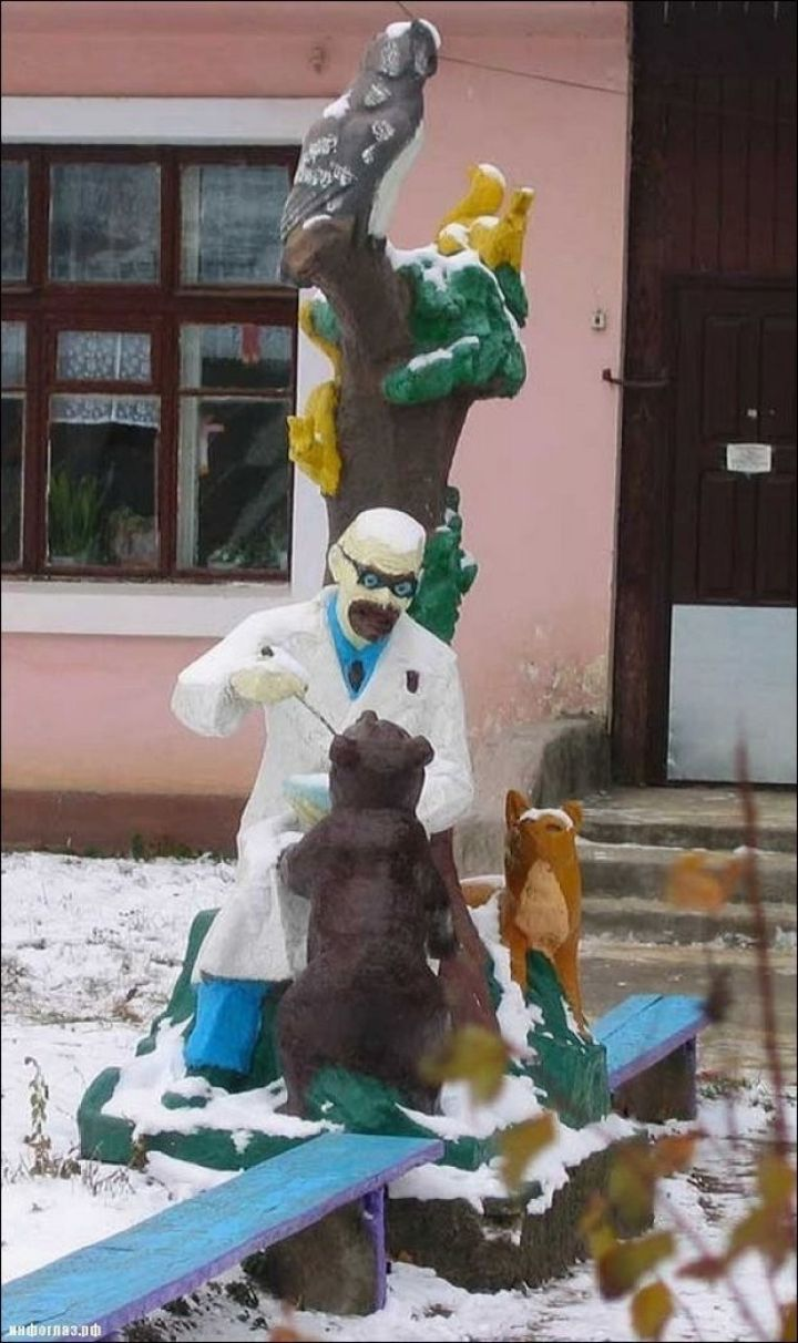 20 Creepy Playgrounds - What is he feeding that bear?