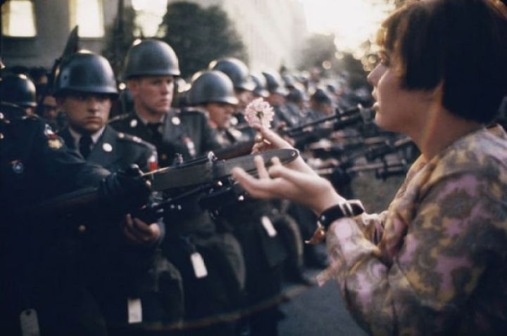29 Powerful Pictures - In 1967, 17-year-old Jan Rose Kasmir offers a flower to soldiers during the Pentagon anti-war protests.