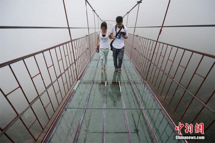 Glass Bridge in China - What makes it even more terrifying is that unlike the glass path on Tianmen Mountain, this bridge is suspended so it also moves in the wind.
