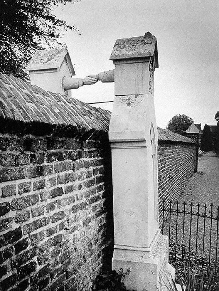 21 Historical Photos - The graves of a Catholic woman and her Protestant husband, Holland, 1888.