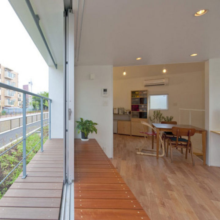 Small House Design in Japan - There are huge sliding windows in the living area that provide access to a small patio.