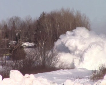 Train Barrels through a Mountain of Snow in New Brunswick.