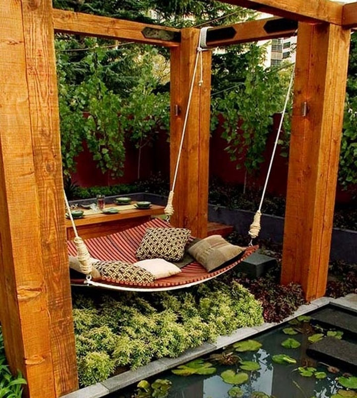 34 DIY Backyard Ideas for the Summer - Construct a giant hammock swing.