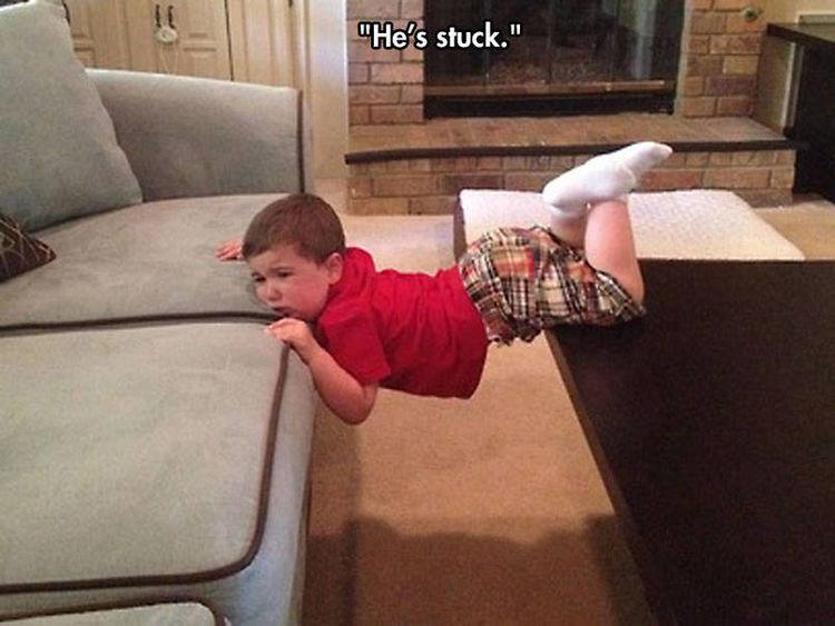 37 Photos of Kids Losing It - He's stuck.