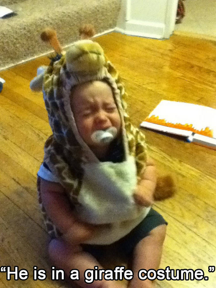 37 Photos of Kids Losing It - He is in a giraffe costume.
