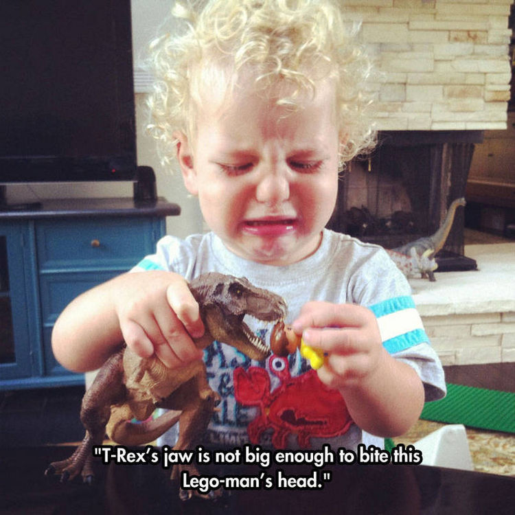 37 Photos of Kids Losing It - T-Rex's jaw is not big enough to bite this Lego-man's head.