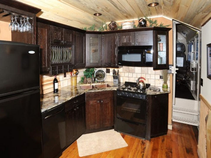 The kitchen is modern and rivals a kitchen you'd find in many homes or condos.