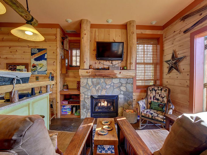 The living area is the perfect place for a cozy evening by the fireplace.