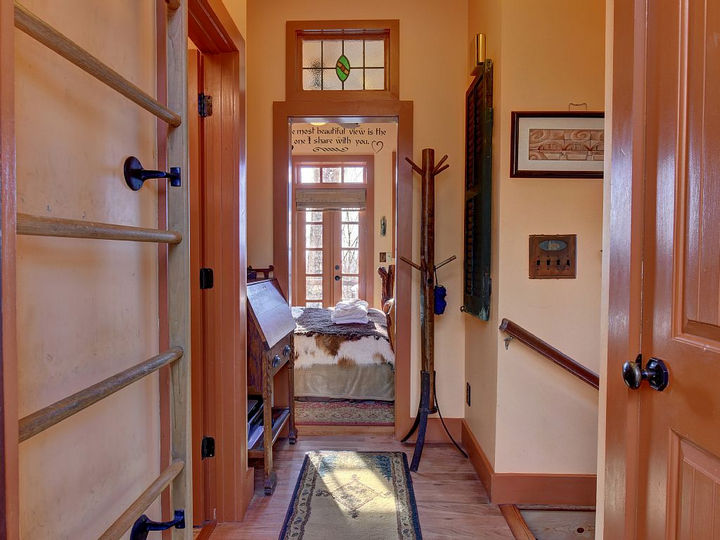 The ladder on the left leads up to a fun kid's room and the main bedroom can be seen straight ahead.