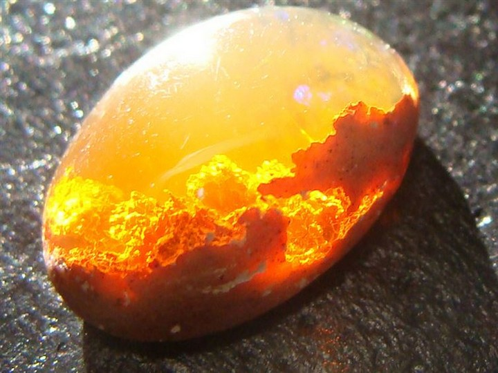 21 Awe-Inspiring Photos - An opal that looks like a sunset behind the clouds.
