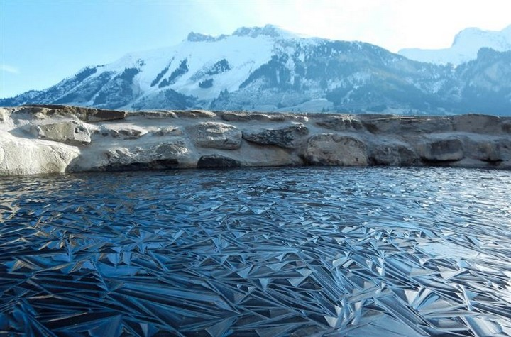 21 Awe-Inspiring Photos - A pond frozen into intricate geometric shapes.