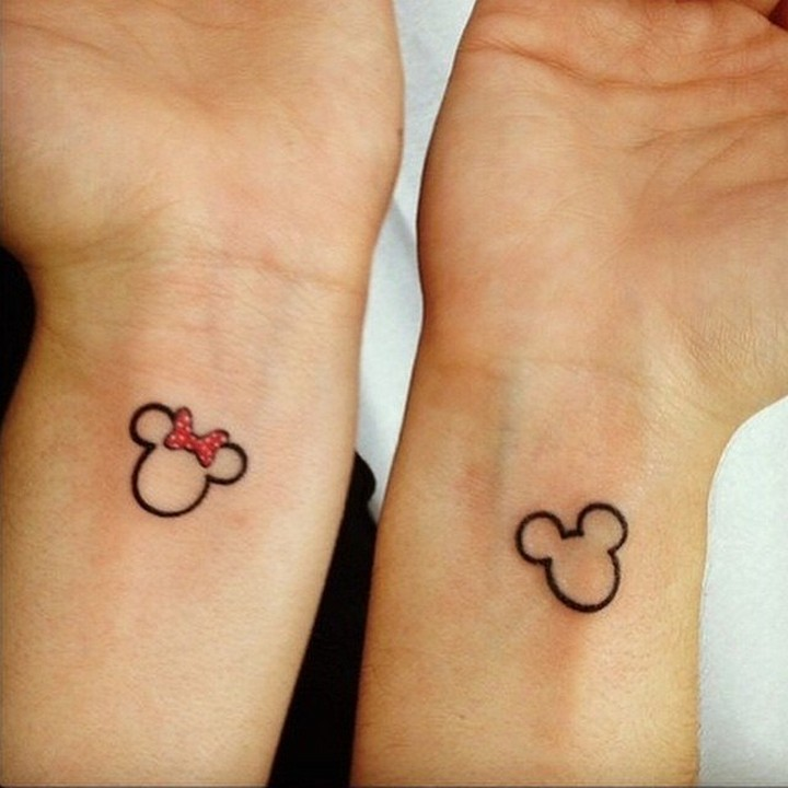 35 couple tattoos - Mickey and Minnie Mouse couple tattoos.