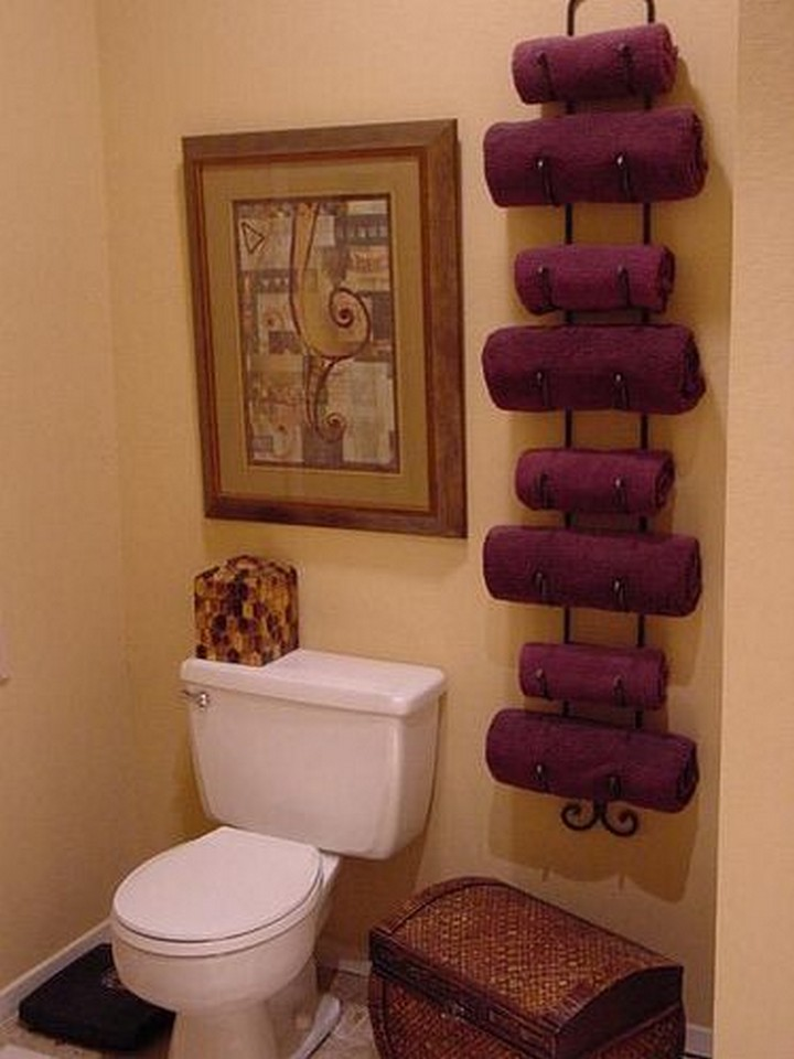 46 Useful Storage Ideas - Use a wine rack to hold bath towels.