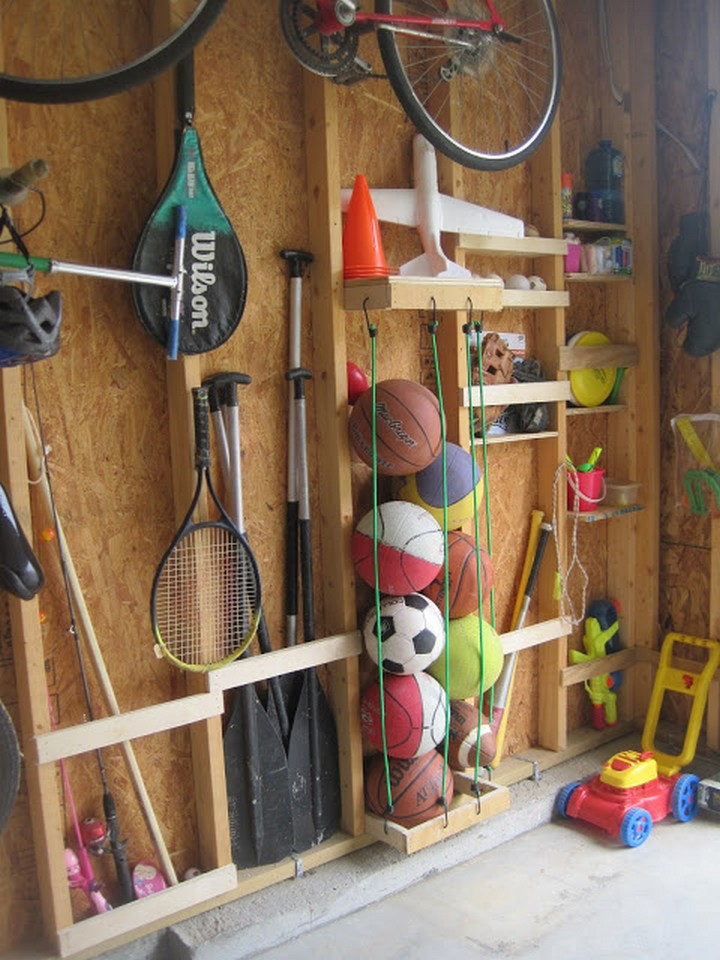 46 Useful Storage Ideas - Organize assorted sports balls using bungee cords.