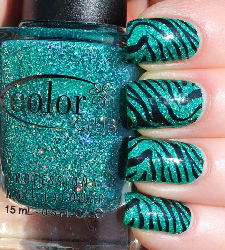 18 Green Manicures - Striking green animal print design.