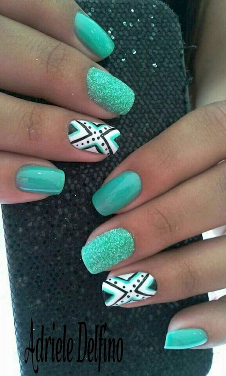 18 Green Manicures - Striking green patterns with accent nails.