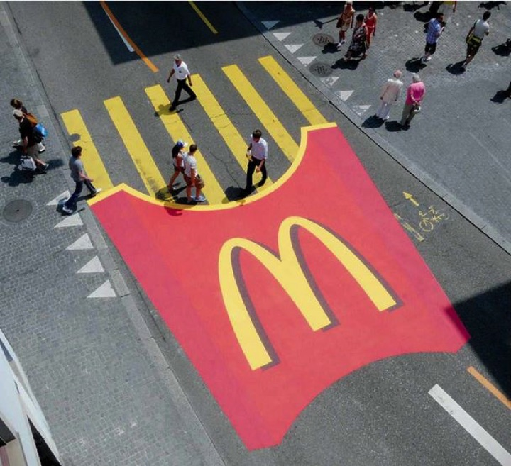 21 Creative Billboard Ads - Pedestrians crossing over French fries.