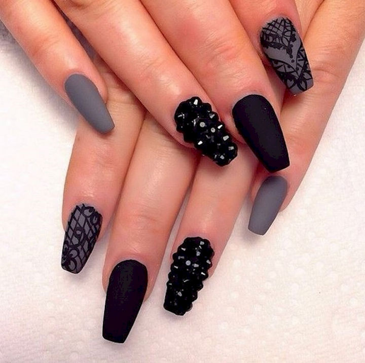 22 Black Nails That Look Edgy and Chic - Show off your creativity with rock nails.