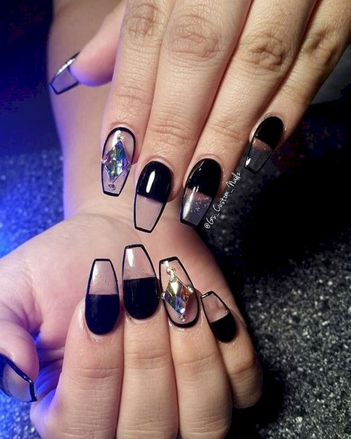 22 Black Nails That Look Edgy and Chic - Rock negative space nails with this look.