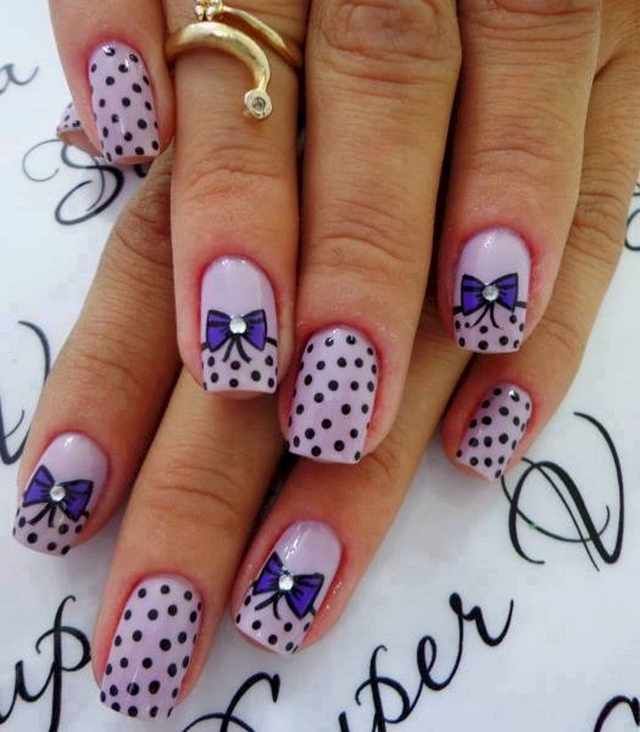 18 Perfectly Manicured Bow Nails - A pretty purple mani with polka dots and bows.