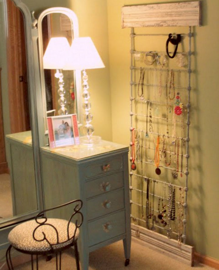 19 Ways to Repurpose Baby Cribs - Build a jewelry display rack.