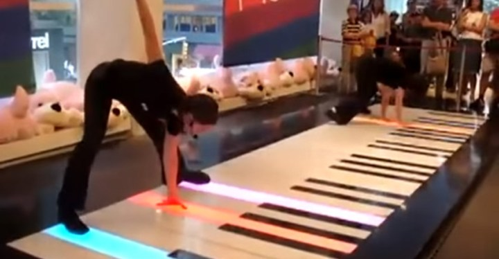 Two Women Playing Bach's Toccata in D on a Giant Floor Piano.