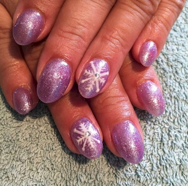 18 3D Nails - A shimmering winter style with textured snowflake accent nails.