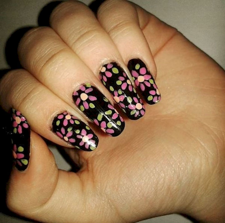 18 Spring Nails - Great contrast with colorful floral nails on a black backdrop.
