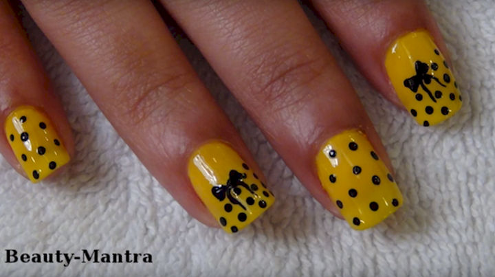 17 Bow Nail Art Designs - Yellow looks great with this polka dot bow nail art design.